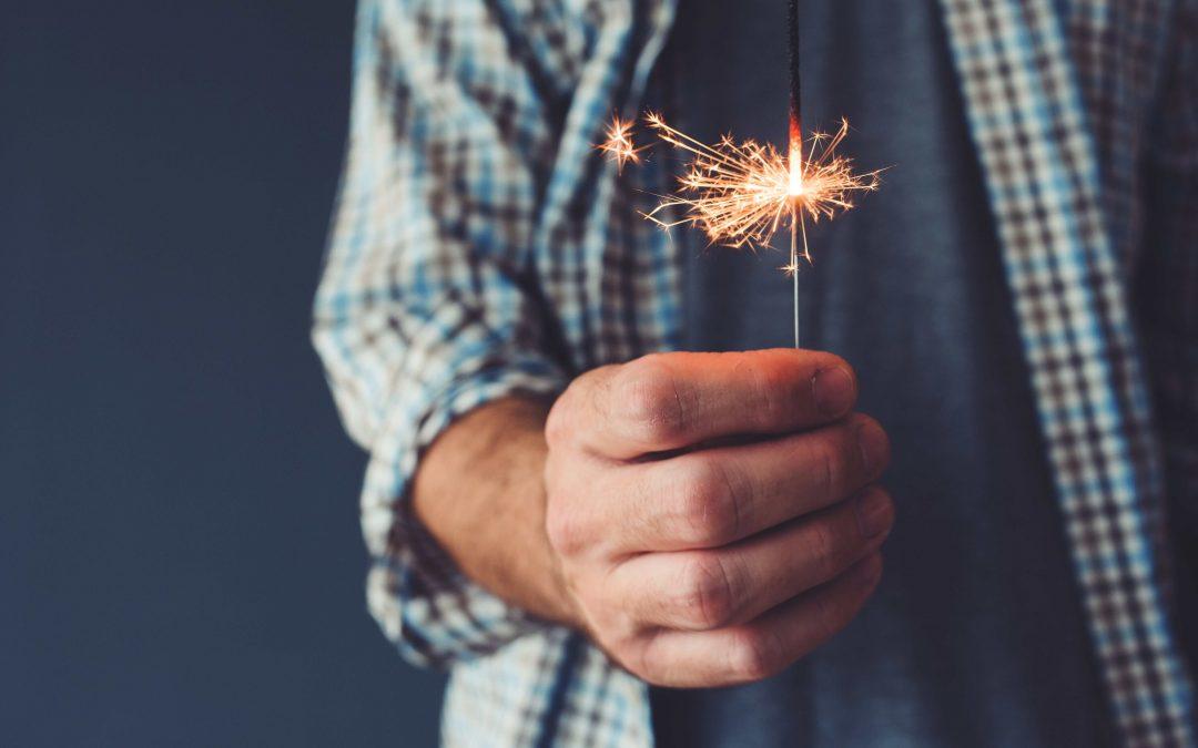 man-holding-stick-sparkler